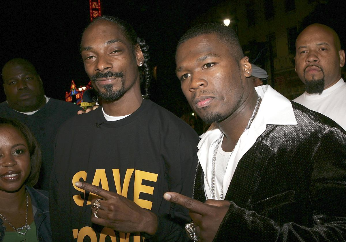 "Rapper Snoop Dogg and actor/Singer Curtis ""50 Cent"" Jackson arrive at the Premiere Of ""Get Rich Or Die Trying"" at Grauman's Chinese Theater on November 2, 2005 in Hollywood, California."