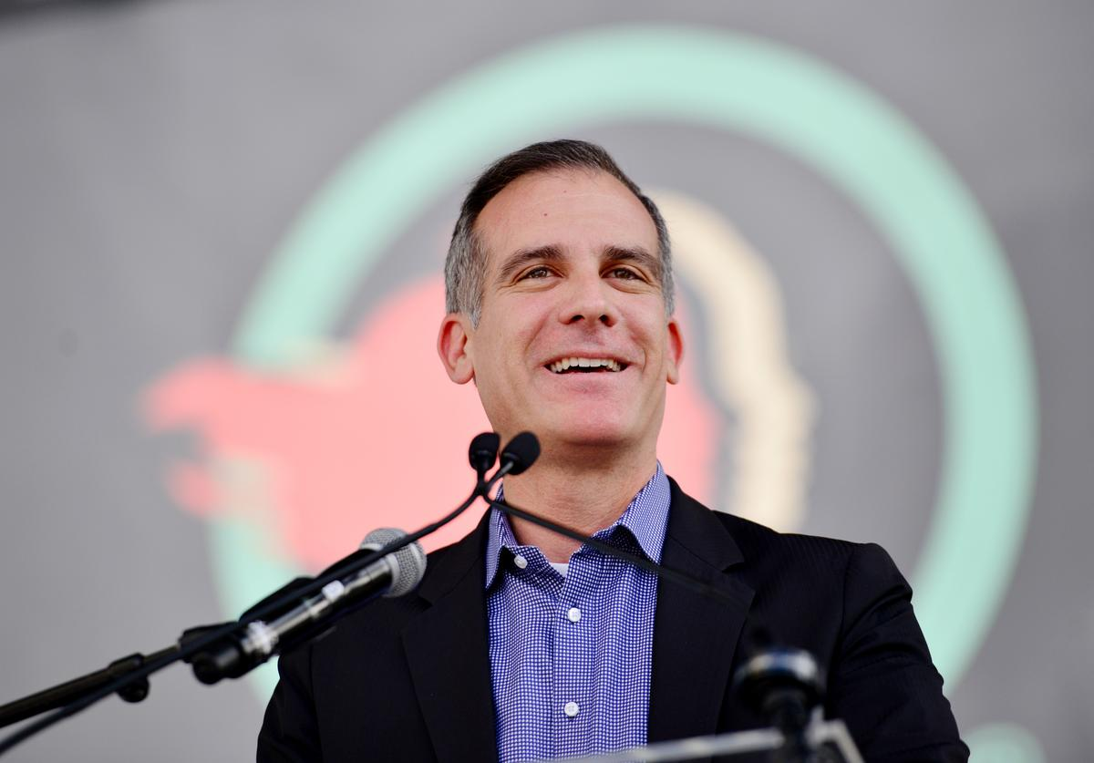 Los Angeles mayor Eric Garcetti budget cuts funds LAPD police communities of colour Black communities invest