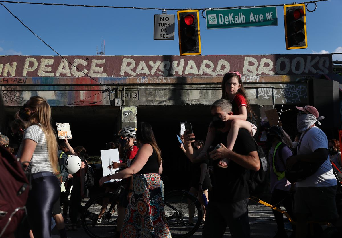 Demonstrators march through the streets against police brutality and racism on June 20, 2020 in Atlanta, Georgia. Demonstrations have been held almost daily around the country after recent police shootings including Rayshard Brooks in a parking lot of a Wendy's restaurant a few miles from where the march was held.