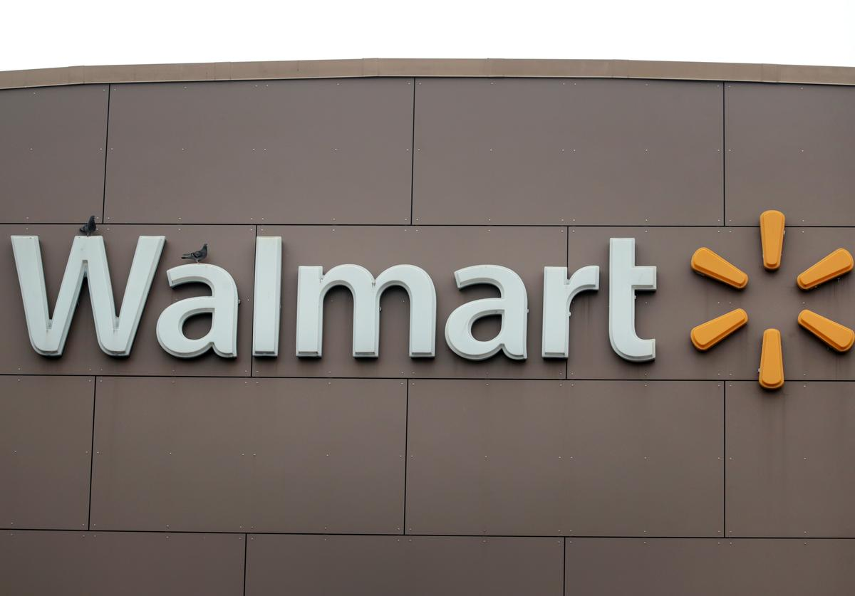 A sign hangs outside of a Walmart store on May 19, 2020 in Chicago, Illinois. Walmart reported a 74% increase in U.S. online sales for the quarter that ended April 30, and a 10% increase in same store sales for the same period as the effects of the coronavirus helped to boost sales.