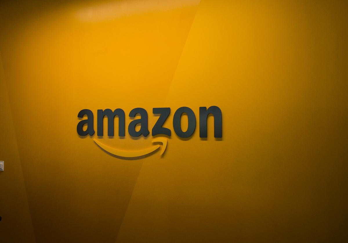 : An Amazon logo is seen inside the Amazon corporate headquarters on June 16, 2017 in Seattle, Washington. Amazon announced that it will buy Whole Foods Market, Inc. for over $13 billion.