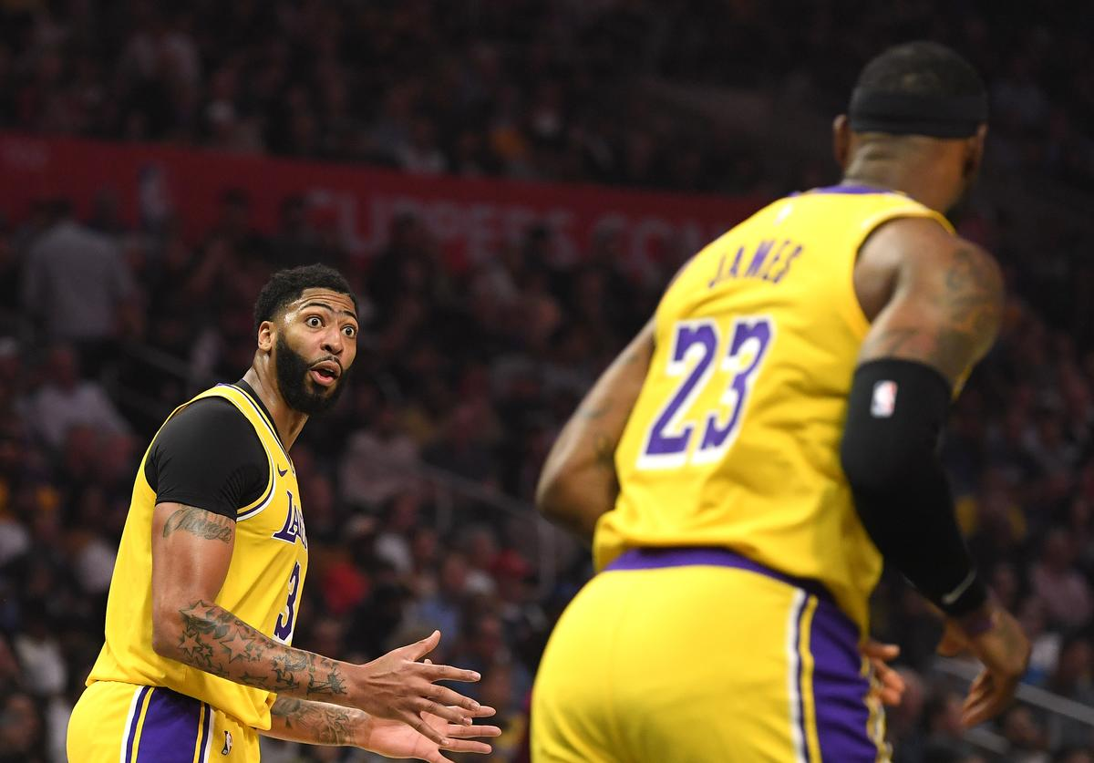 Anthony Davis #3 of the Los Angeles Lakers reacts toward LeBron James #23 during the first half in the LA Clippers season home opener at Staples Center on October 22, 2019 in Los Angeles, California.