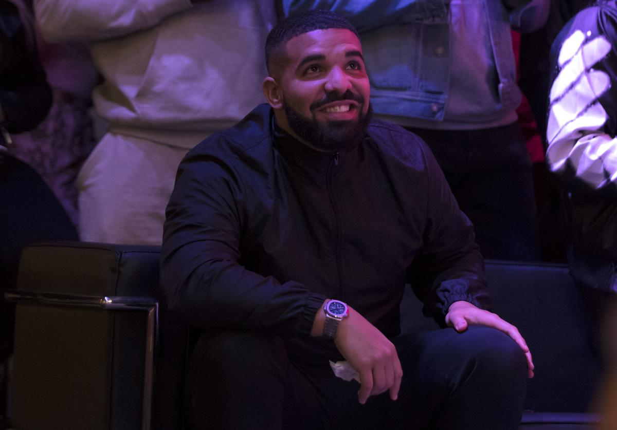 Toronto rapper Drake watches a screen alongside other Toronto Raptors fans as they gather to watch Game Six of the NBA Finals outside of Scotiabank Arena on June 13, 2019 in Toronto, Canada.