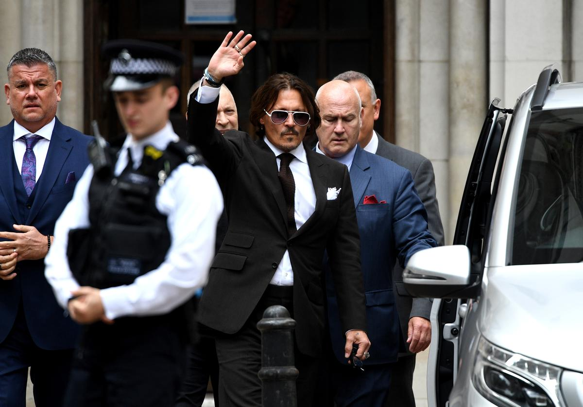 Johnny Depp waves as he leaves the Royal Courts of Justice, Strand on July 10, 2020 in London, England.