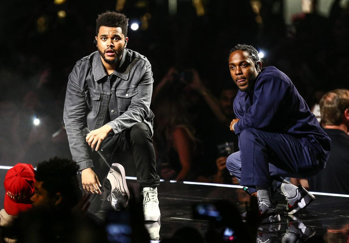 """In this handout photo provided by The Forum, Kendrick Lamar joins The Weeknd on stage during the """"Legends of The Fall Tour"""" to perform """"Sidewalks"""" on April 29, 2017 at The Forum in Inglewood, California."""