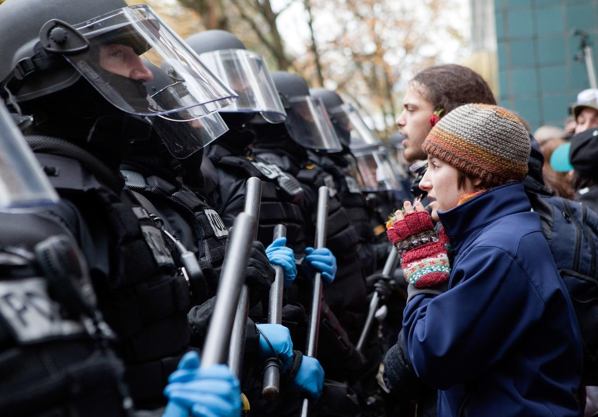 A protester pleads with police during a demonstration near the Occupy Portland encampment November 13, 2011 in Portland, Oregon.