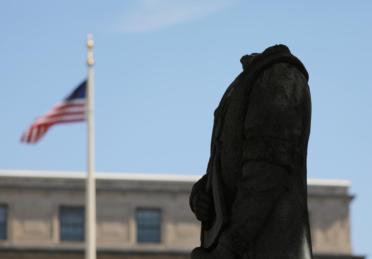 The headless statue of Christopher Columbus stands outside of Waterbury's city hall on July 05, 2020 in Waterbury, Connecticut.