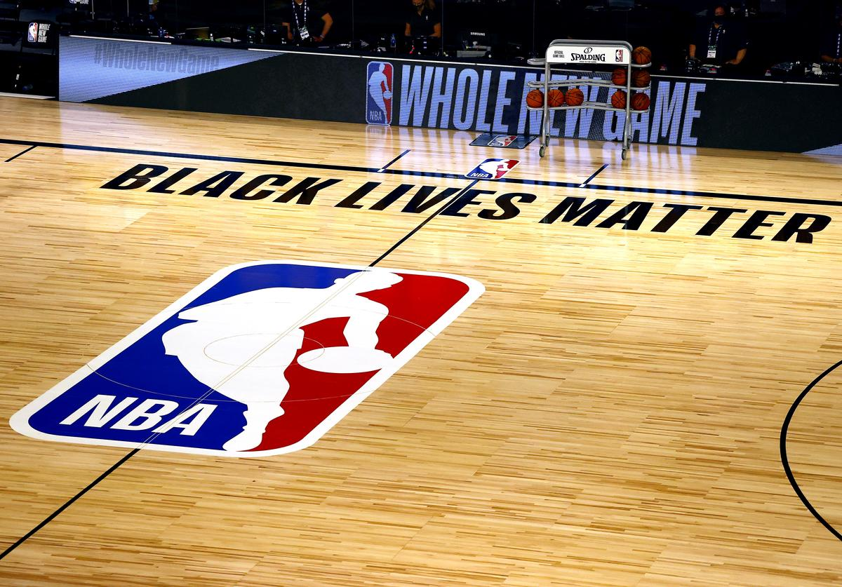 An overview of the basketball court shows the NBA logo and Black Lives Matter before the start of a game between the Denver Nuggets and the Miami Heat at HP Field House at ESPN Wide World Of Sports Complex on August 01, 2020 in Lake Buena Vista, Florida.