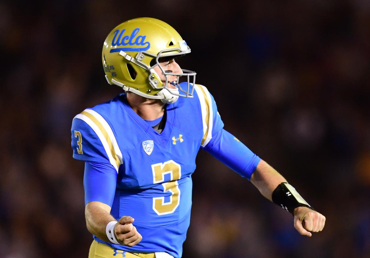 Josh Rosen #3 of the UCLA Bruins celebrates his touchdown pass for a 7-3 lead over the California Golden Bears during the first quarter at Rose Bowl on November 24, 2017 in Pasadena, California.