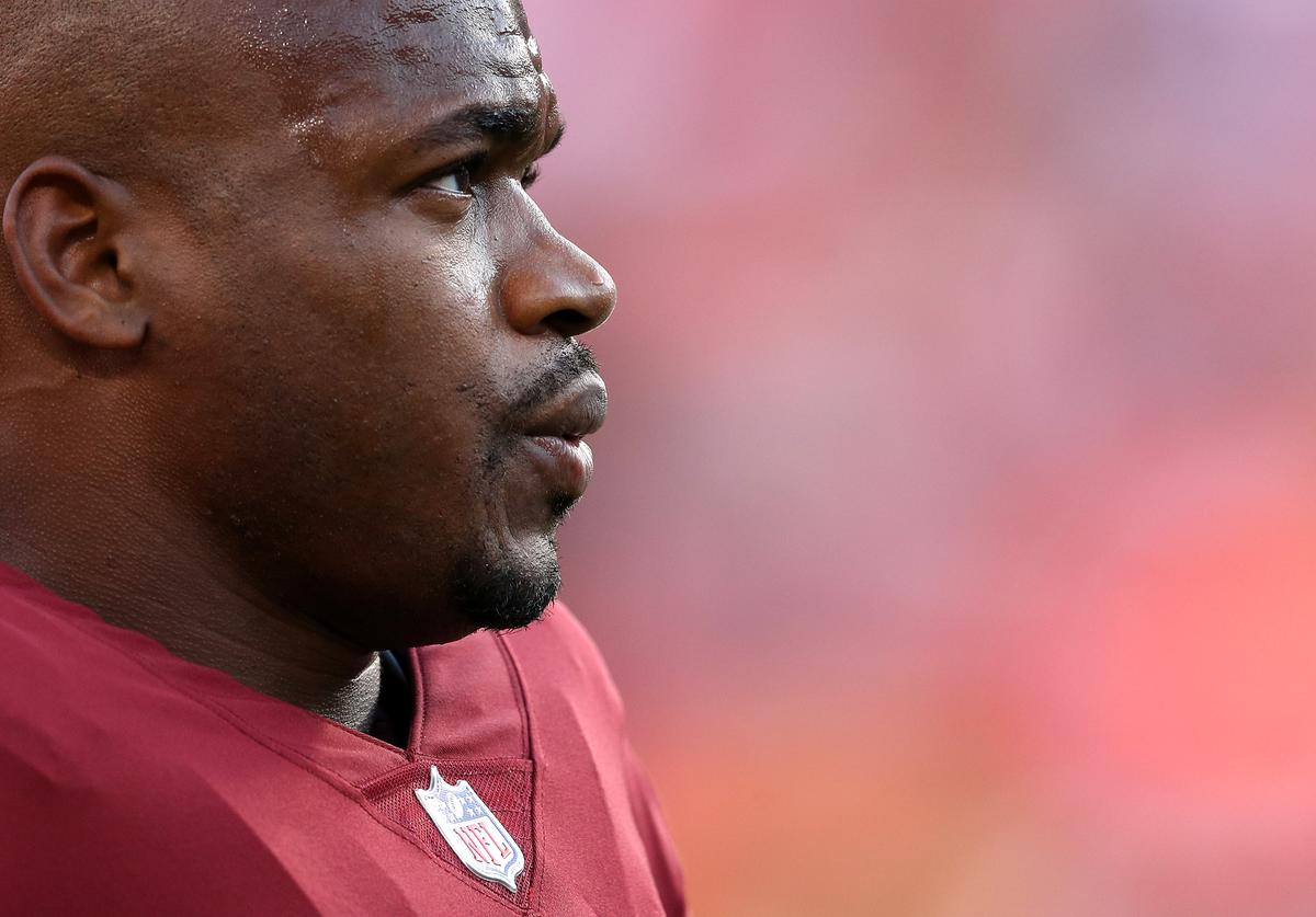 Running back Adrian Peterson #26 of the Washington Redskins looks on before playing the Denver Broncos during a preseason game at FedExField on August 24, 2018 in Landover, Maryland.