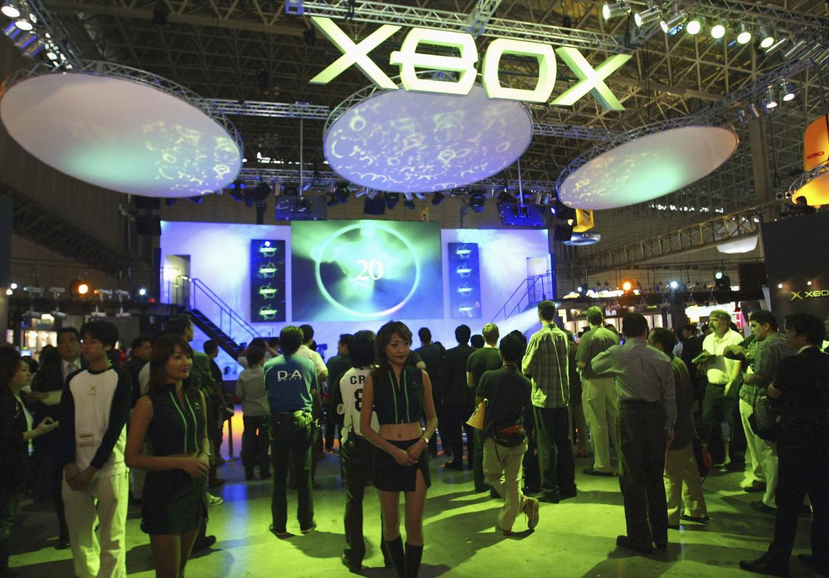 People gather to play the games on display at the X-Box booth during the Tokyo Game Show on September 24, 2004 in Makuhari, Chiba Prefecture, Japan. The Tokyo Game Show, the largest of it's kind, takes place from 24th to 26th for three days.