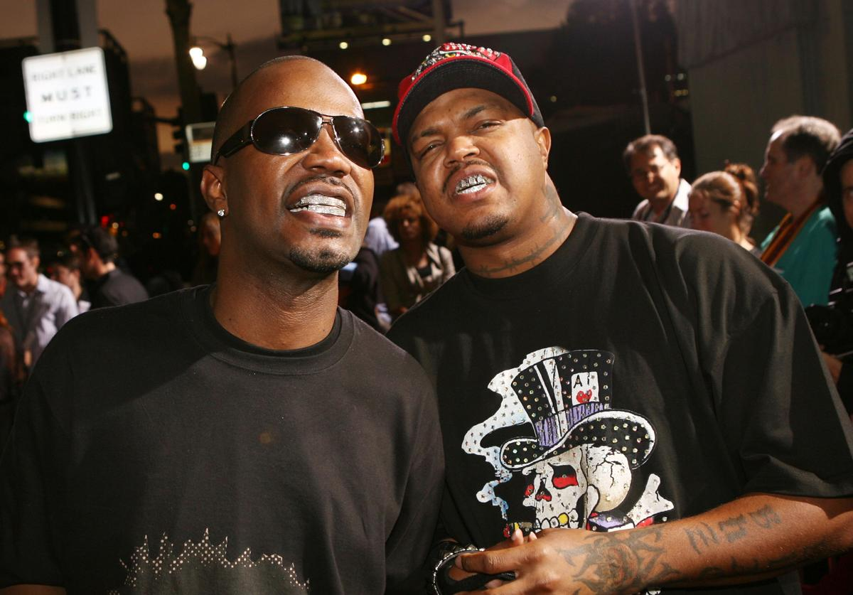"""Rappers Three 6 Mafia, Juicy J (L) and DJ Paul, arrive at the premiere of Paramount's """"Jackass Number Two"""" at the Chinese Theater on September 21, 2006 in Los Angeles, California."""