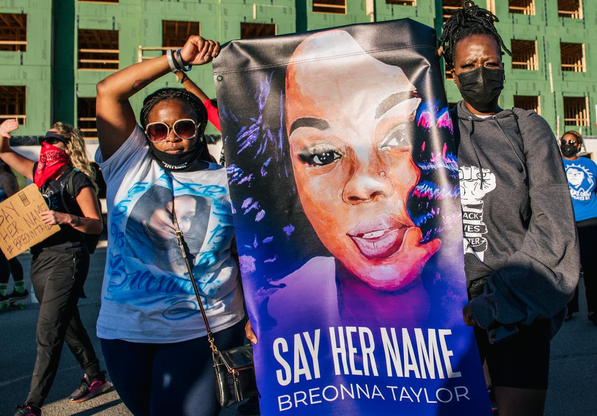 Activists gather in Louisville to protest the death of Breonna Taylor