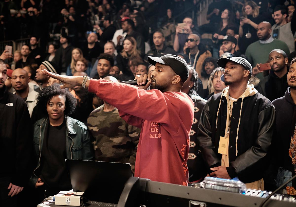 Kanye West performs during his Yeezy Season 3 fashion show.