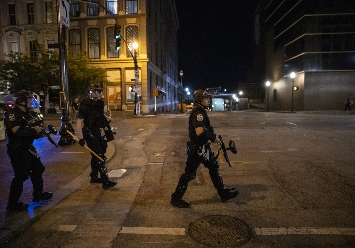 Police in riot gear disperse crowds gathered to protest the death of Breonna Taylor.