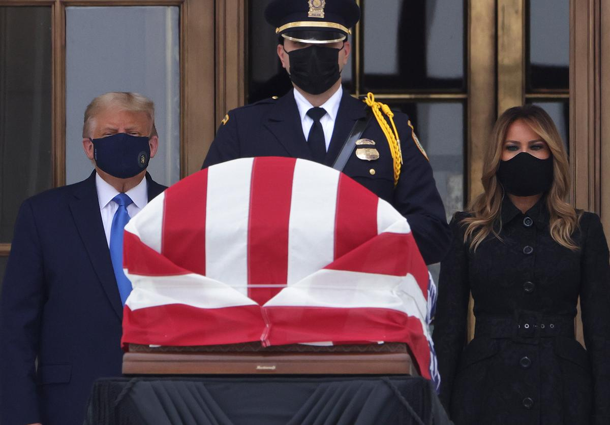 U.S. President Donald Trump and first lady Melania Trump pay their respects to Associate Justice Ruth Bader Ginsburg's flag-draped casket