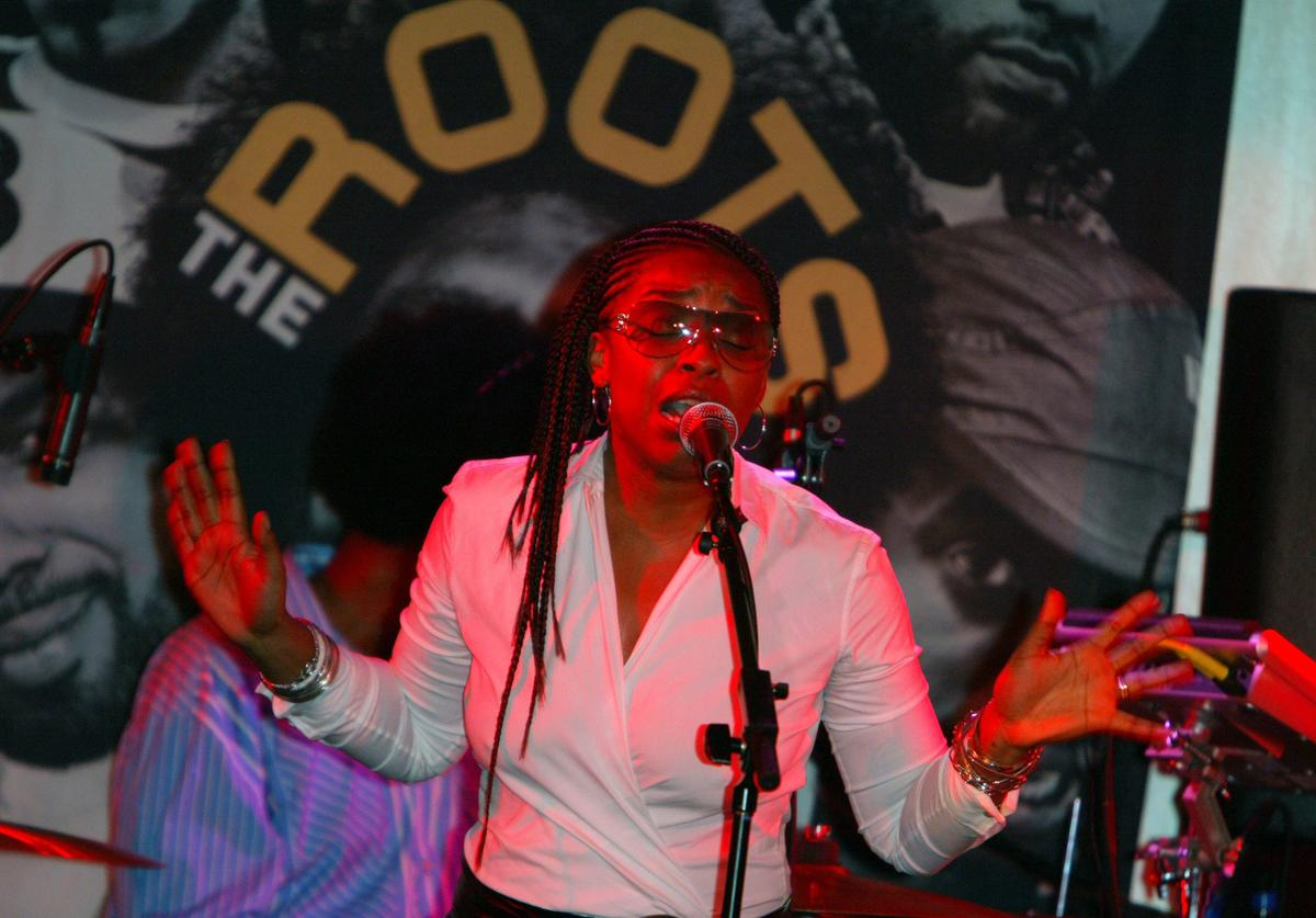 Jaguar Wright performing onstage with The Roots.