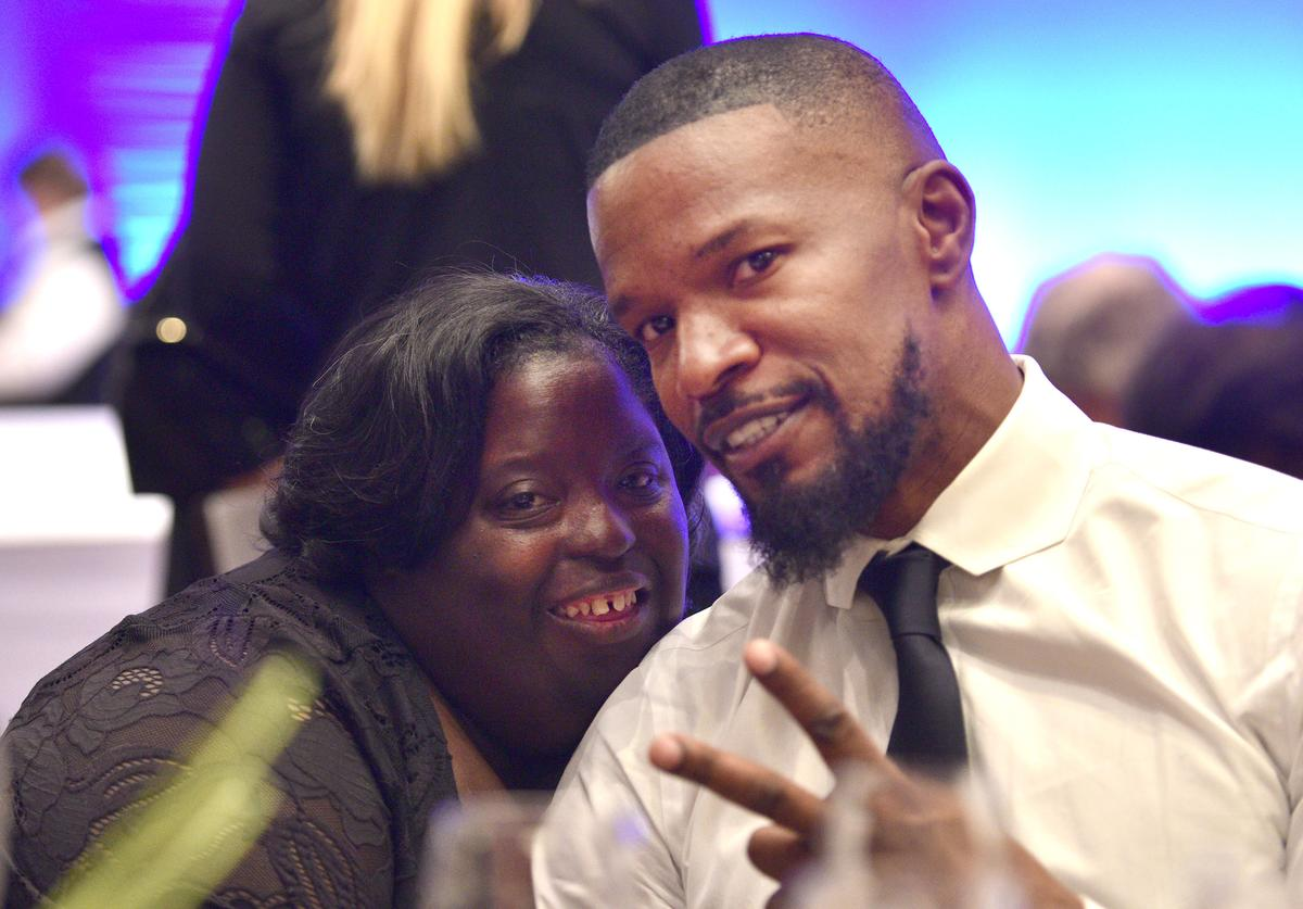 DeOndra Dixon with Jamie Foxx at the Global Down Syndrome Foundation's 9th annual Be Beautiful Be Yourself Fashion Show at Sheraton Denver Downtown Hotel on November 11, 2017 in Denver, Colorado. (