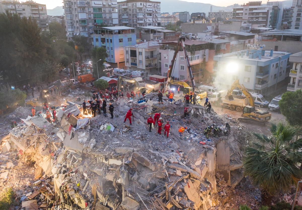 Emergency services personnel search a collapsed building for survivors the day after a powerful earthquake struck on October 31, 2020 in Izmir, Turkey. Twenty-four people have been killed and more than eight hundred injured after an earthquake struck the Aegean Sea off the coast of Turkey's Izmir Province. More than twenty buildings were destroyed in Izmir, Turkey's third largest city.
