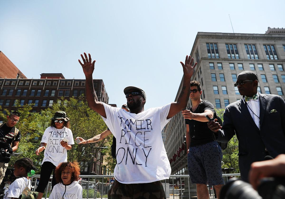 A man speaks out against the shooting of 12 year-old Tamir Rice by police near the site of the Republican National Convention (RNC) in downtown Cleveland on the second day of the convention on July 19, 2016 in Cleveland, Ohio. Many people have stayed away from downtown due to road closures and the fear of violence. An estimated 50,000 people are expected in Cleveland, including hundreds of protesters and members of the media. The four-day Republican National Convention kicked off on July 18.