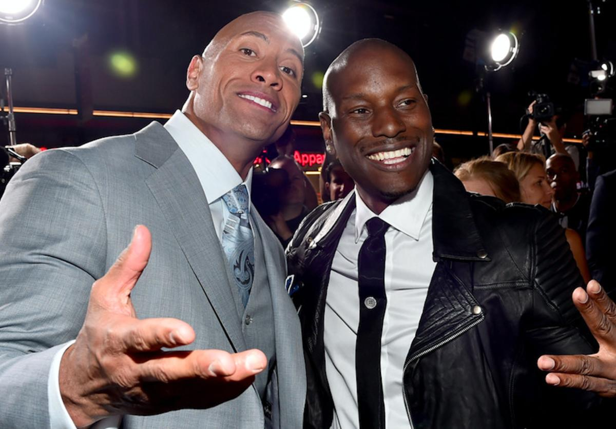 "Dwayne 'The Rock' Johnson (L) and recording artist/actor Tyrese Gibson attend Universal Pictures' ""Furious 7"" premiere"