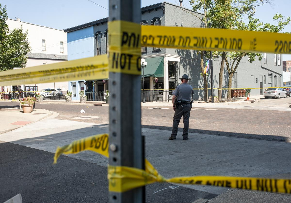 Law enforcement officials investigate the scene where a gunman opened fire on a crowd of people over night on Fifth Avenue in the Oregon District on August 4, 2019 in Dayton, Ohio. In the second mass shooting in the U.S. within 24 hours a gunman left nine dead and another 27 wounded after only a minute of shooting.