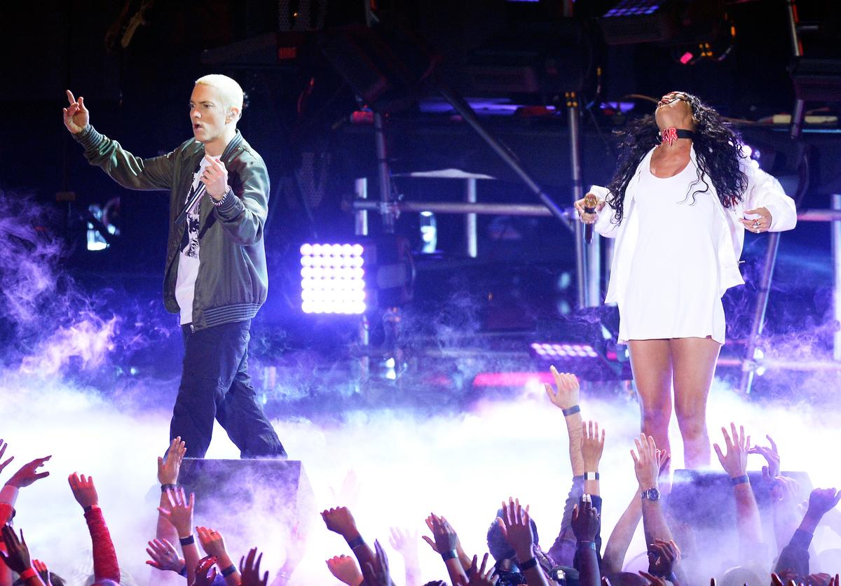 Recording artists Eminem (L) and Rihanna perform onstage at the 2014 MTV Movie Awards at Nokia Theatre L.A. Live on April 13, 2014 in Los Angeles, California.