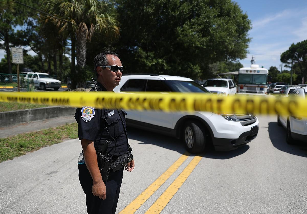 Police tape marks off the entrance to the apartment building where shooting suspect Omar Mateen is believed to have lived on June 12, 2016 in Fort Pierce, Florida. The mass shooting at Pulse nightclub in Orlando, Florida killed at least 50 people and injured 53 others in what is the deadliest mass shooting in the country's history.