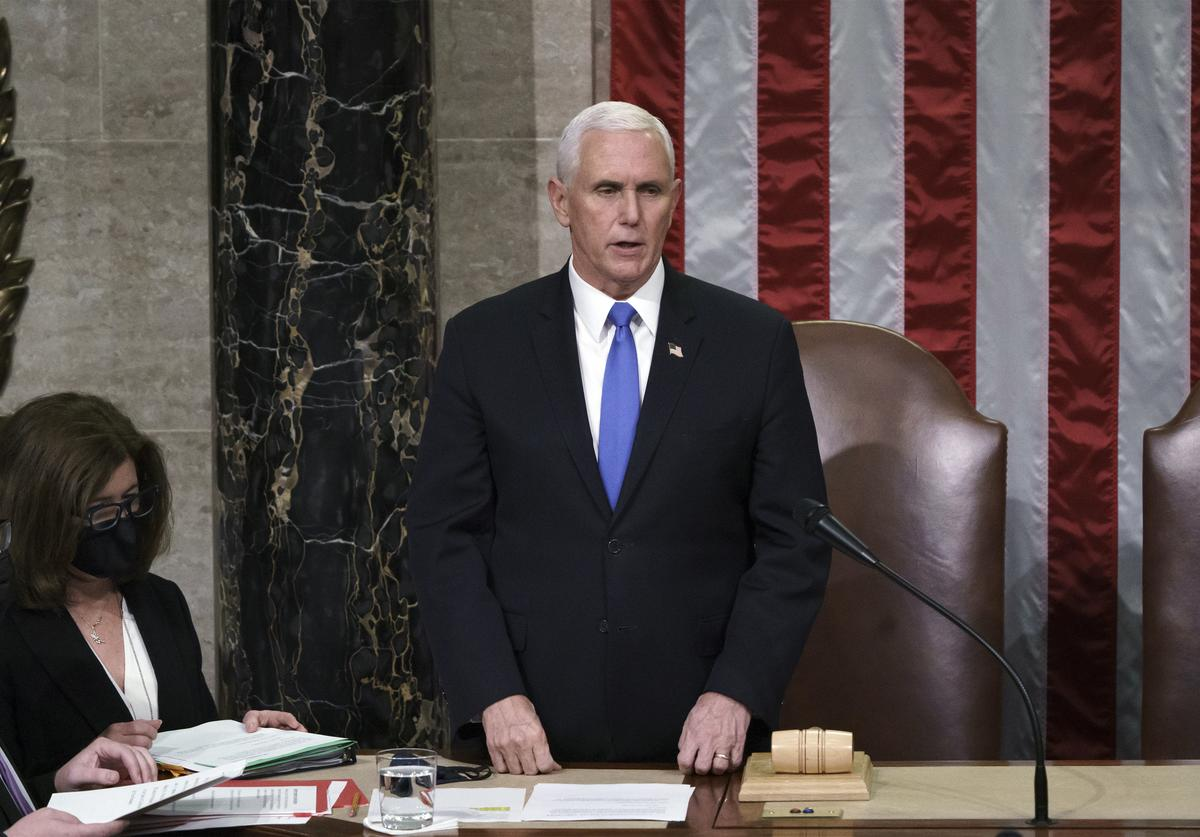 Vice President Mike Pence reads the final certification of Electoral College votes cast in November's presidential election during a joint session of Congress, after working through the night, at the Capitol on January 7, 2021 in Washington, DC. Congress reconvened to ratify President-elect Joe Biden's 306-232 Electoral College win over President Donald Trump, hours after a pro-Trump mob broke into the U.S. Capitol and disrupted proceedings.