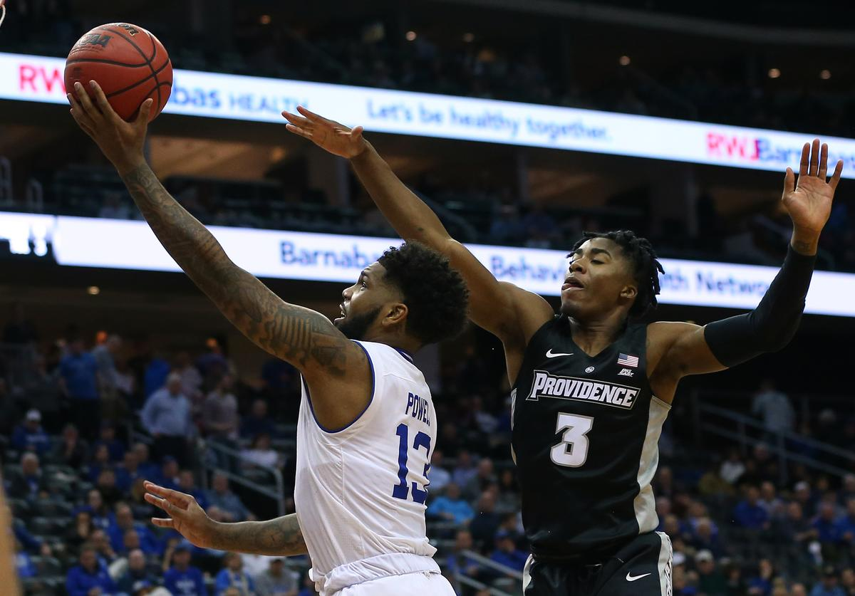Myles Powell #13 of the Seton Hall Pirates attempts a layup as David Duke #3 of the Providence Friars defends during the second half of a college basketball game at Prudential Center on January 22, 2020 in Newark, New Jersey. Seton Hall defeated Providence 73-64. (