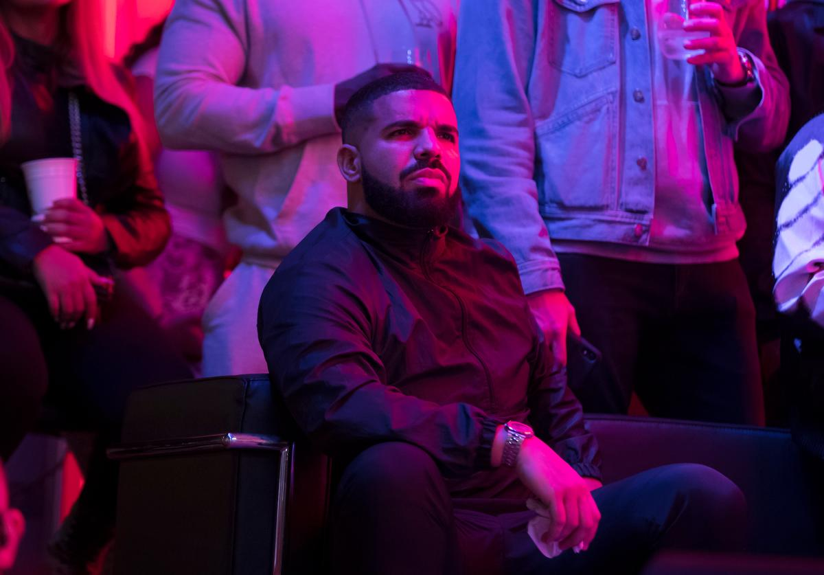 Toronto rapper Drake watches a screen alongside other Toronto Raptors fans as they gather to watch Game Six of the NBA Finals