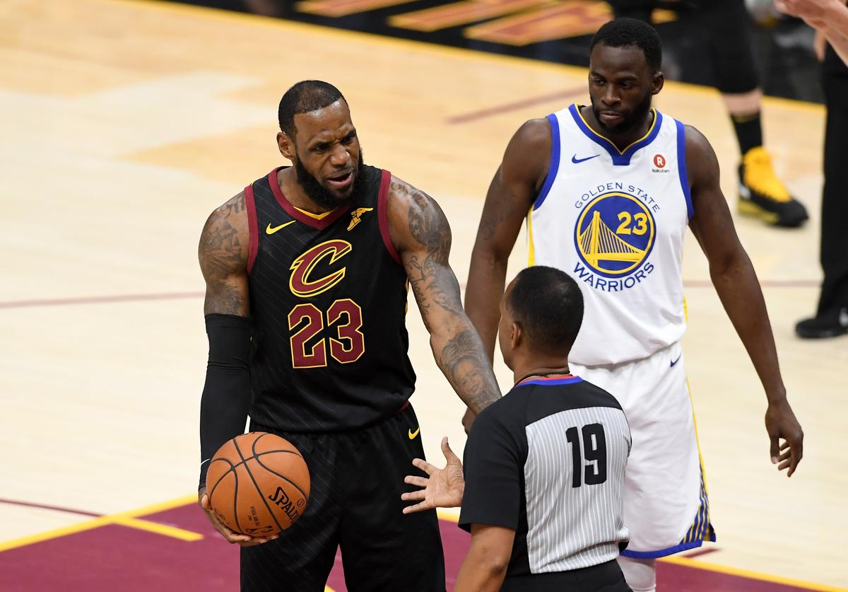 LeBron James #23 of the Cleveland Cavaliers speaks to referee James Capers #19 in the first quarter against the Golden State Warriors during Game Four of the 2018 NBA Finals at Quicken Loans Arena on June 8, 2018