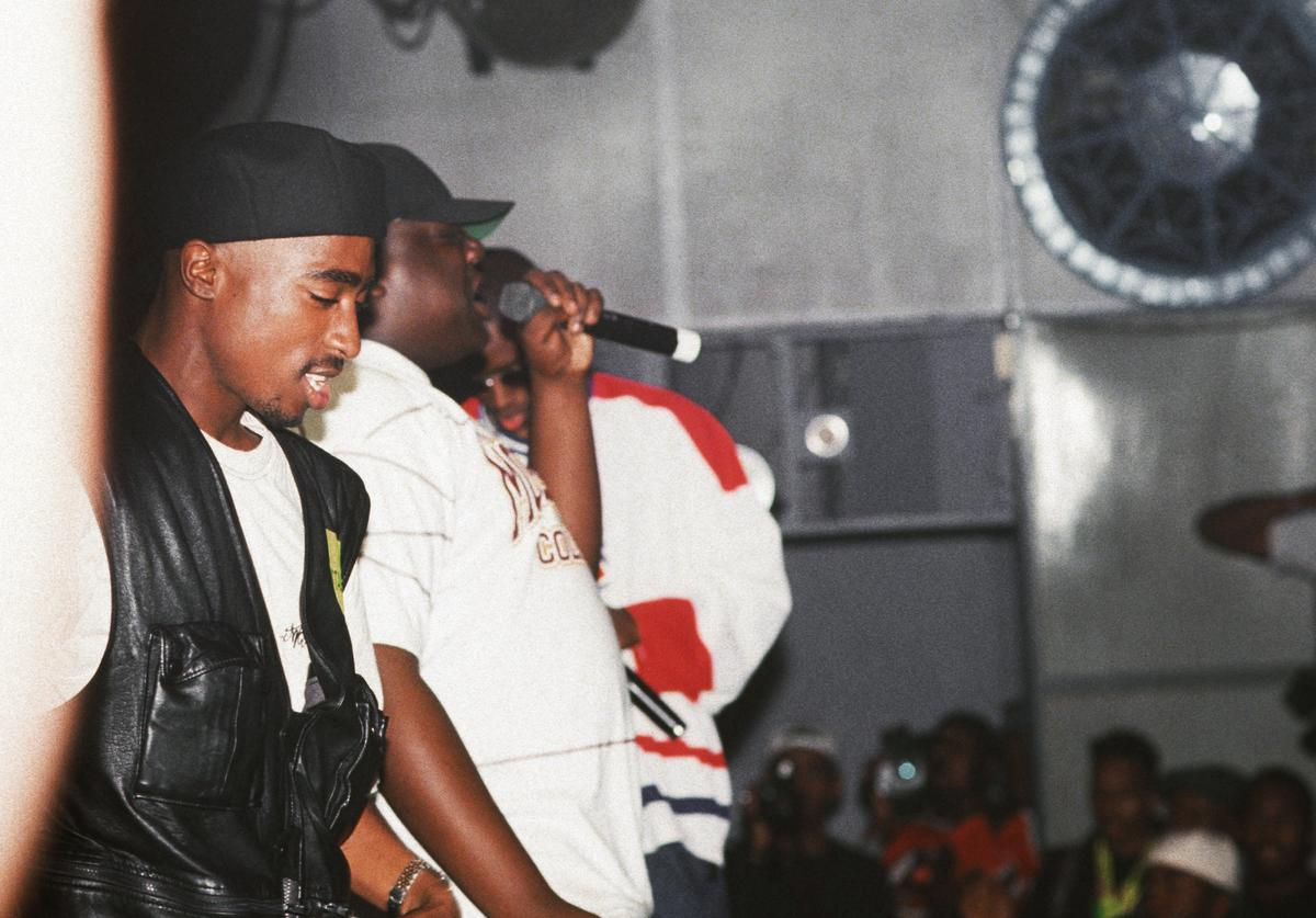 Rappers Tupac Shakur, The Notorious B.I.G. aka Biggie Smalls (Christoper Wallace) and Puff Daddy (sean Combes) perform onstage at the Palladium on July 23, 1993