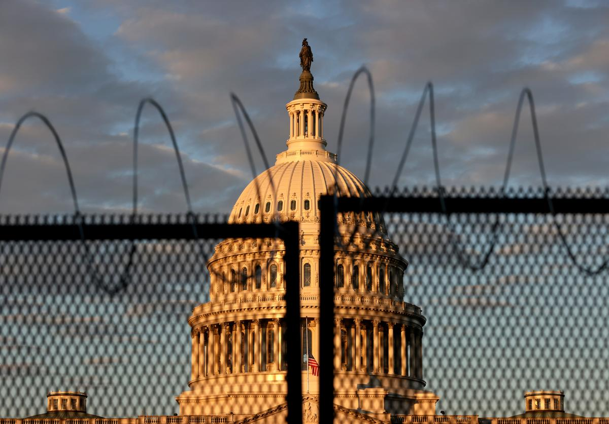 The U.S. Capitol is seen behind a fence with razor wire during sunrise on January 16, 2021 in Washington, DC