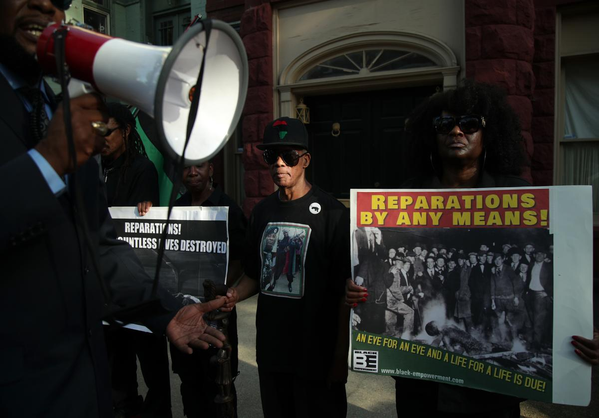 Activists stage a protest to mark the National Reparations Day outside the residence of U.S. Senate Majority Leader Sen. Mitch McConnell