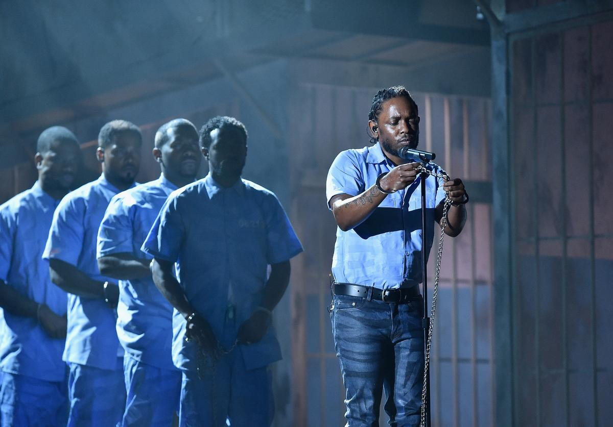 rapper Kendrick Lamar (C) performs onstage during The 58th GRAMMY Awards at Staples Center on February 15, 2016 in Los Angeles, California