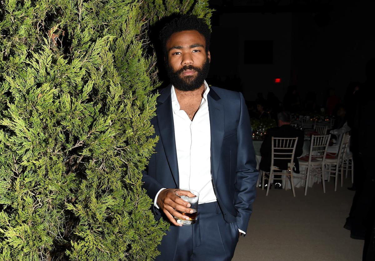 Childish Gambino hangs out with a bush at the CDFA/Vogue awards.