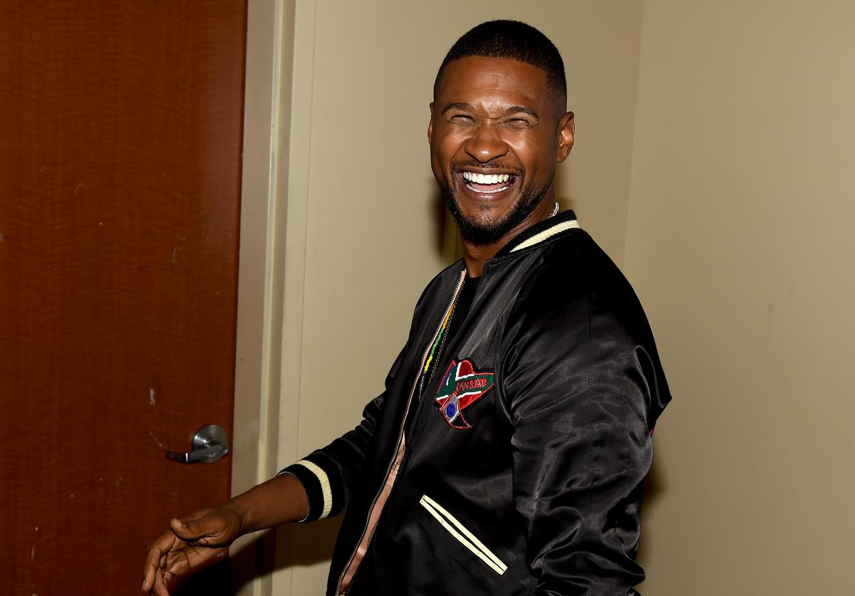 Usher smiling big