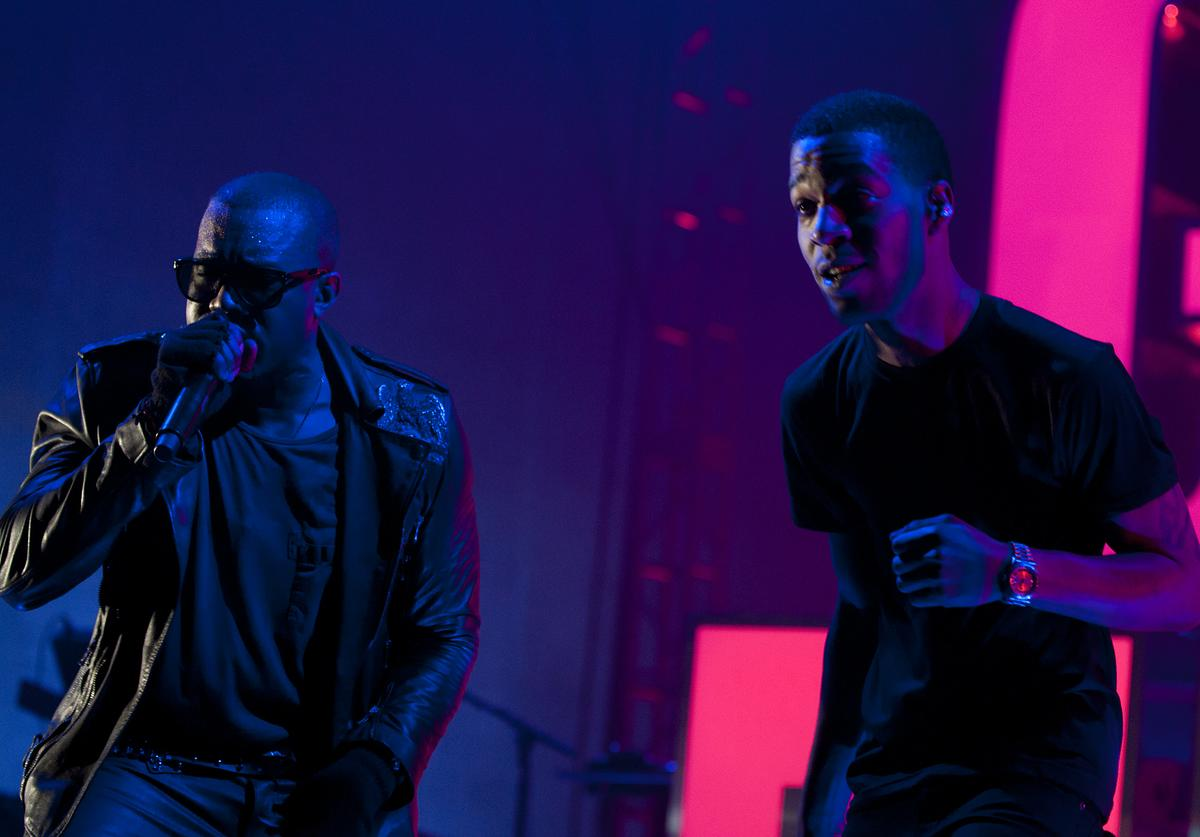 Kid Cudi and Kanye West performing in 2011