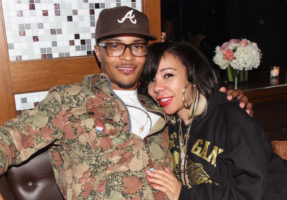 T.I. and Tiny hugging