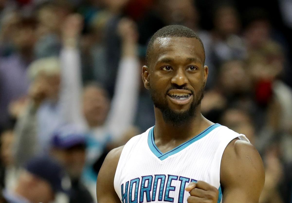 Kemba Walker #15 of the Charlotte Hornets reacts after defeating the Los Angeles Lakers 117-113 during their game at Spectrum Center on December 20, 2016 in Charlotte, North Carolina.