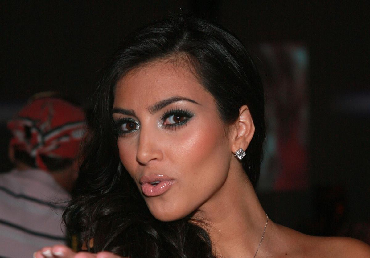 Socailite Kim Kardashian attends the Ashley Paige swimwear fashion show during 'Mercedes Benz Fashion Week: Miami Swim' in the Cabana Grande tent at the Raleigh Hotel on July 13, 2007 in Miami Beach.