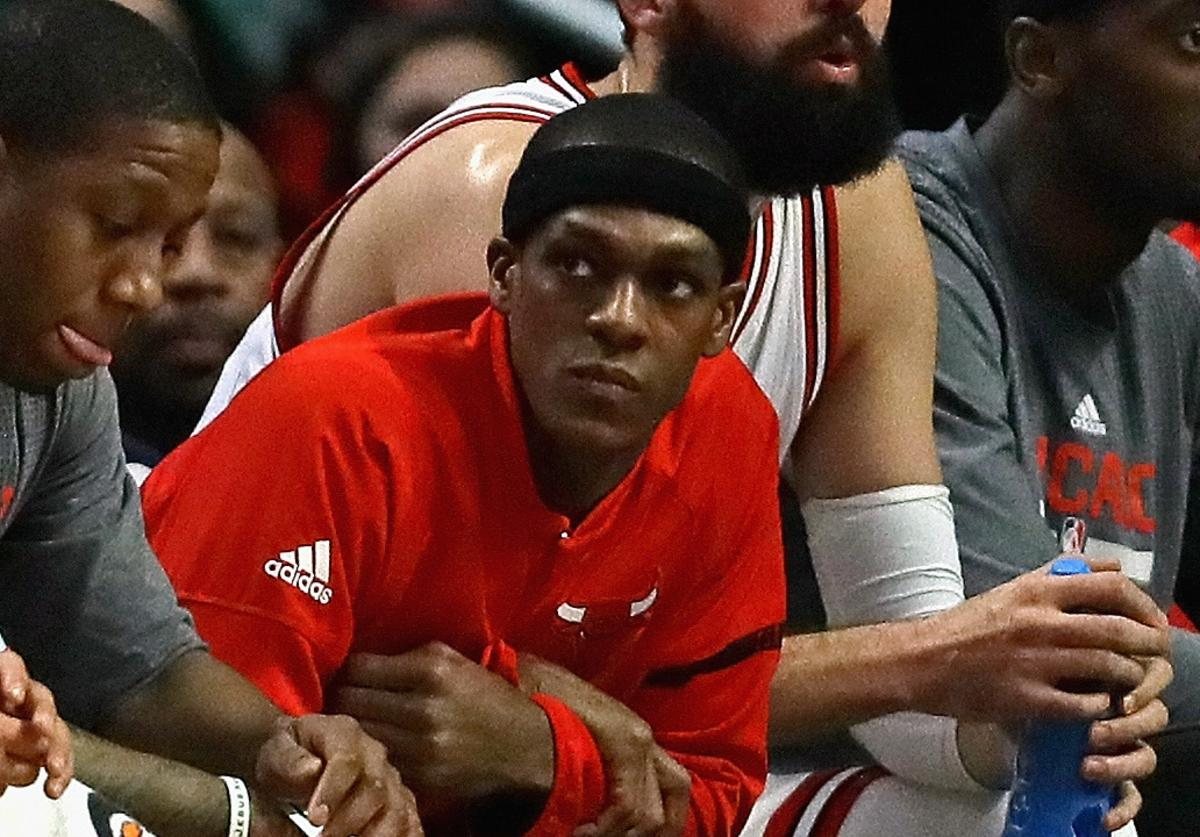 Rajon Rondo #9 of the Chicago Bulls sits on the bench as the Bulls take on the Charlotte Hornets at the United Center on January 2, 2017 in Chicago, Illinois.