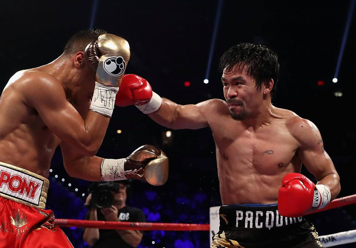 Manny Pacquiao (R) lands a right on Jessie Vargas during their WBO welterweight championship fight at the Thomas & Mack Center on November 5, 2016 in Las Vegas, Nevada.