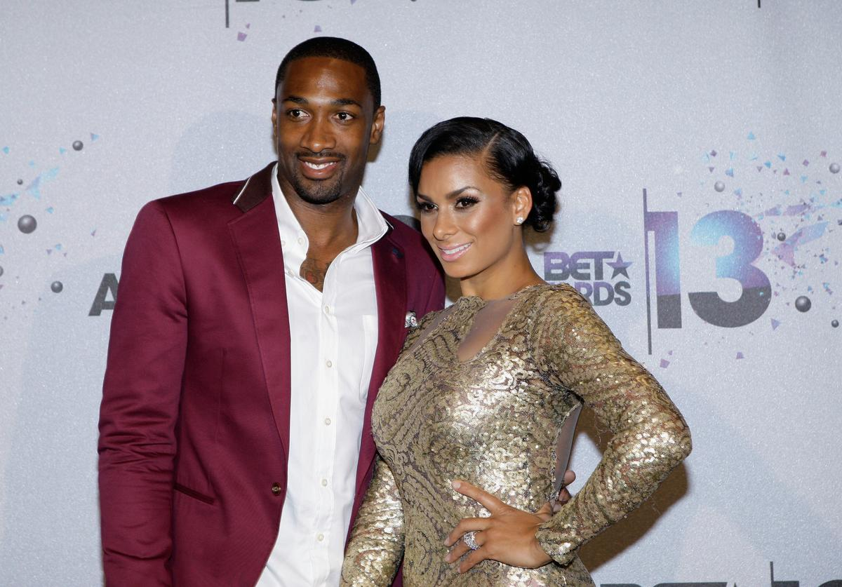 NBA player Gilbert Arenas and tv personality Laura Govan pose in the Backstage Winner's Room at Nokia Theatre L.A. Live on June 30, 2013 in Los Angeles, California.