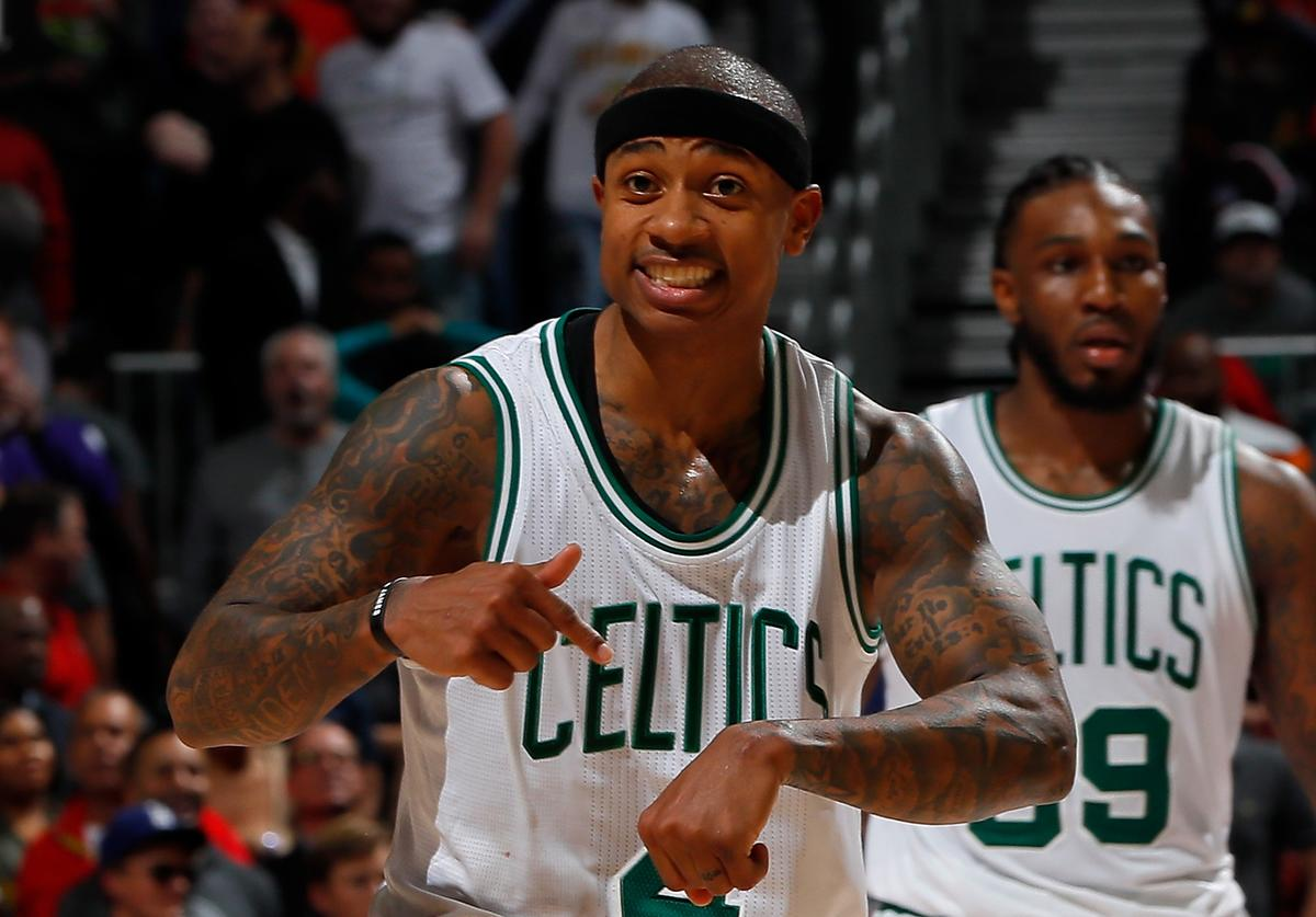 saiah Thomas #4 of the Boston Celtics reacts after hitting a three-point basket in the final minute of their at 103-101 against the Atlanta Hawks Philips Arena on January 13, 2017 in Atlanta, Georgia.