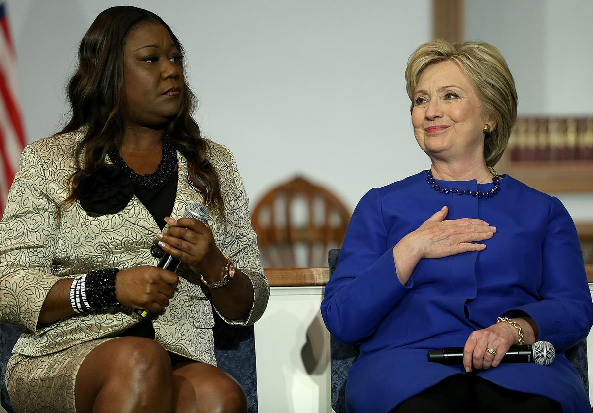 U.S. presidential candidate, former Secretary of State Hillary Clinton listens as Sybrina Fulton, mother of Trayvon Martin, speaks at the Central Baptist Church February 23, 2016 in Columbia, South Carolina. The South Carolina Democratic primary is February 27.