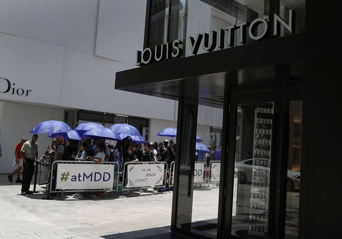 Crowds Line Up For Limited Edition Supreme And Louis Vuitton Collaboration Clothing Items