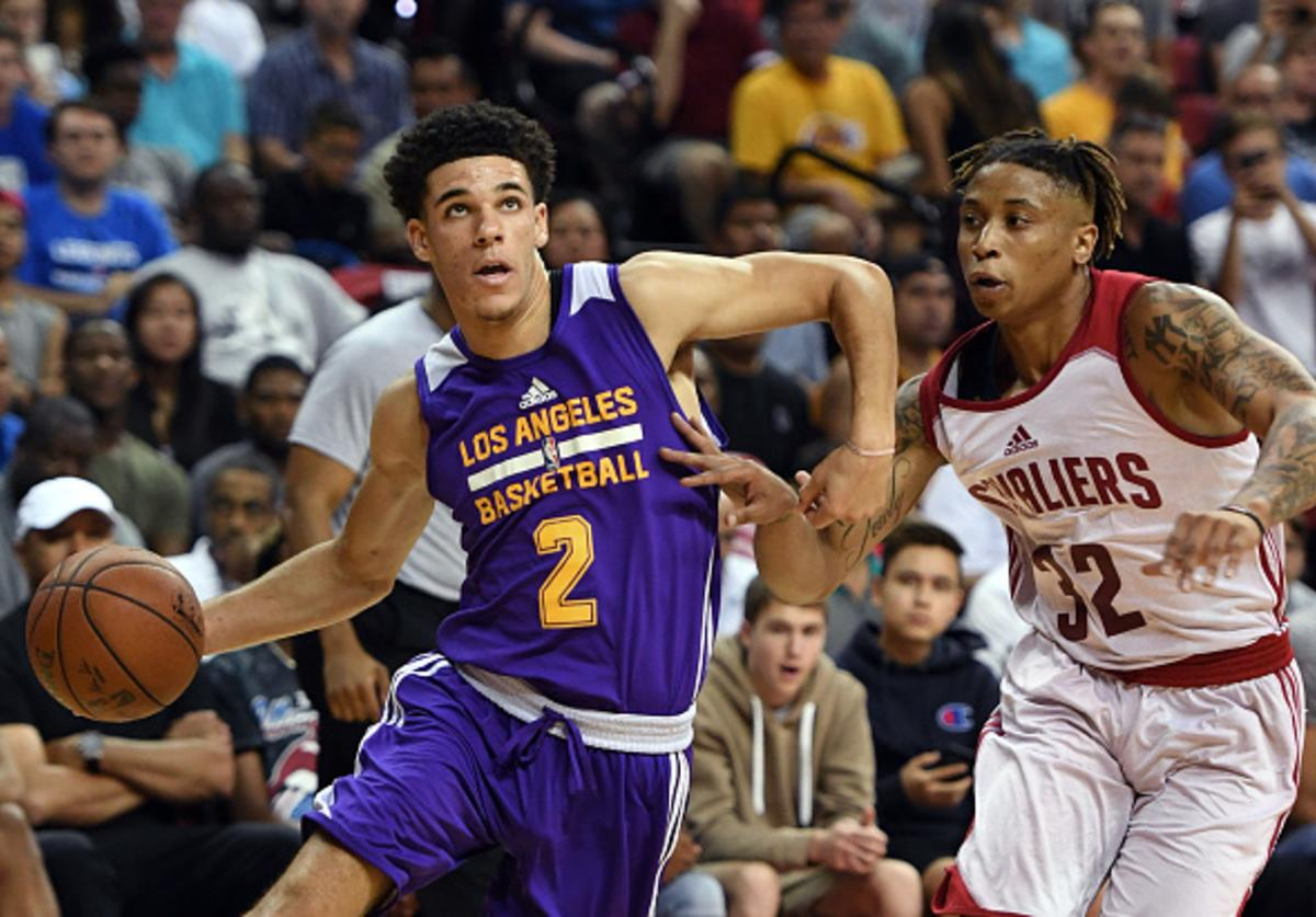 Lonzo drives against T.J. Williams