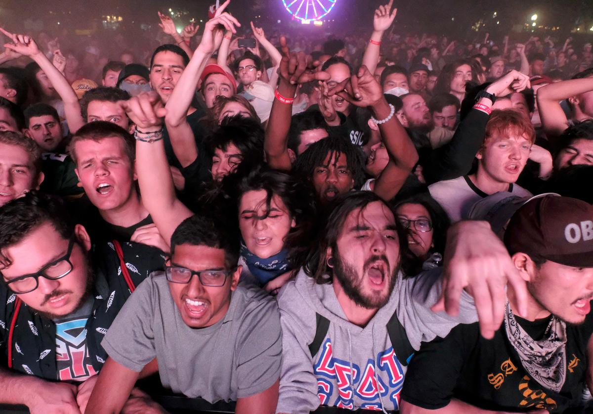 Festival goers watch Death Grips perform on Flog Stage during day two of Tyler, the Creator's 5th Annual Camp Flog Gnaw Carnival at Exposition Park on November 13, 2016 in Los Angeles, California.